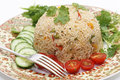 Tomato biryani and fork a healthy thakkali biriyani with a salad of cucumber cherry tomatoes some fresh leaves closeup with a this Royalty Free Stock Photography