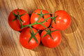 Tomato, bunch of vegetables on a wooden table, view from above Royalty Free Stock Photo