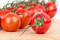 Tomato cherry branch on wooden board Stock Images