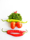 Tomato and chillies forming to funny face in white background Stock Photo
