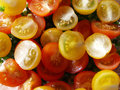 Tomato close up red and yellow cheries Royalty Free Stock Photo