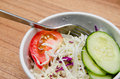 Tomato cucumber and cabbage salad in a white bowl Royalty Free Stock Image