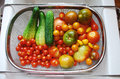 Tomato and cucumber harvest in kitchen sink a day s of ripe cucumbers tomatoes cherry yellow pear orange cherry black beefsteak Royalty Free Stock Photography