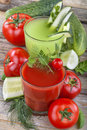 Tomato and cucumber juices healthy domestic on a wooden table Royalty Free Stock Images