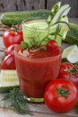 Tomato and cucumber juices healthy domestic on a wooden table Royalty Free Stock Photos
