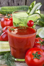 Tomato and cucumber juices on a wooden table Stock Photo