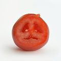 Tomato cutted shows a stuffy face Stock Image