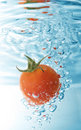 Tomato drop in water Royalty Free Stock Images