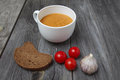 Tomato gazpacho soup with bread and garlic in white bowl. horizontal Royalty Free Stock Photo