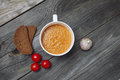 Tomato gazpacho soup with bread and garlic in white bowl on wood Royalty Free Stock Photo