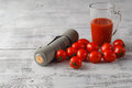 Tomato juice in glass, fresh tomatoes on vintage wooden cutting Royalty Free Stock Photo