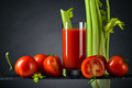 Tomato juice with tomatoes and celery sticks