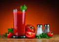 Tomato juice and tomatoes still life with glass of fresh parsley salt pepper Stock Image