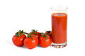 Tomato juice and tomatos isolated over white background Stock Images