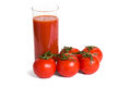 Tomato juice and tomatos isolated over white background Royalty Free Stock Image