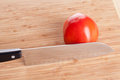 Tomato and knife Royalty Free Stock Image