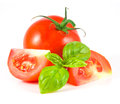 Tomato with leaf of basil Royalty Free Stock Images