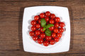 Tomato many red tomatoes on plate Royalty Free Stock Photography