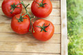 Tomato new crop on wooden table in garden top view Royalty Free Stock Images