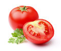 Tomato with parsley on a white background Royalty Free Stock Photos