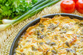 Tomato pie with cheddar cheese mayonnaise green onions and parsley Stock Image