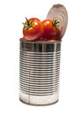 Tomato red tomtoes in a tin jar Stock Images