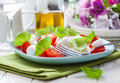 Tomato salad with mozzarella small and basil Royalty Free Stock Photography