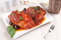 Tomato sauce braised chicken with olives and basil Stock Photos