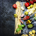 Tomato sauce, olive oil, pesto and pasta Royalty Free Stock Photo