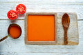 Tomato sauce on square dish and white wood Royalty Free Stock Photo