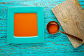 Tomato sauce on square turquoise dish Royalty Free Stock Photo