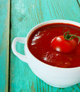 Tomato sauce on a wooden background Stock Photo