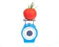 Tomato on scale Royalty Free Stock Photo