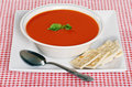 Tomato soup in a bowl with basil Royalty Free Stock Photo