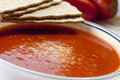Tomato soup in a bowl with healthy and fresh ingredients and crackers Royalty Free Stock Photos