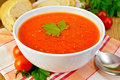 Tomato soup in bowl on napkin with bread Royalty Free Stock Photo