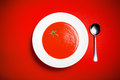 Tomato soup a bowl of on a red background Royalty Free Stock Photo