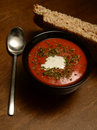 Tomato soup and bread savory in rustic cozy setting Royalty Free Stock Image