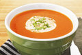 Tomato soup with cream homemade and parsley in a green bowl Stock Photo