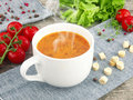 Tomato soup with fresh ingredients in a soup cup Royalty Free Stock Photos