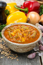 Tomato soup with lentils and vegetables on wooden table vertical Stock Image