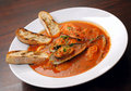 Tomato soup with seafood and toasts