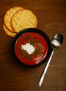 Tomato soup warm on a dark wooden table for an autumn meal Stock Photography