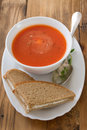 Tomato soup in white bowl Royalty Free Stock Photo