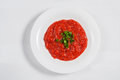 Tomato soup in a white bowl isolated background. Top view Royalty Free Stock Photo