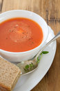 Tomato soup in white bowl with sandwich Royalty Free Stock Photo