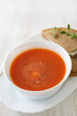 Tomato soup in white bowl with sandwich on white Royalty Free Stock Photo