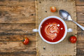 Tomato soup in white cup, top view Royalty Free Stock Photo