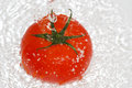 Tomato in splashing water Stock Photo