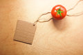 Tomato vegetable and price tag on wood background texture Royalty Free Stock Photos